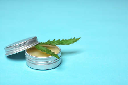 Jar with hemp lotion and space for text on color background Standard-Bild