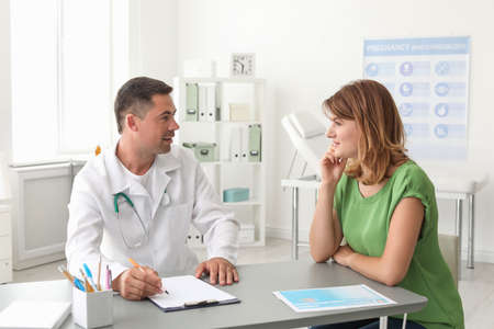 Patient having appointment with doctor in hospital
