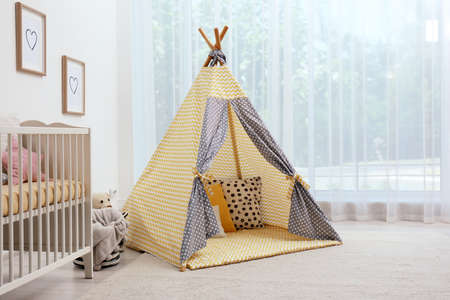 Cozy baby room interior with play tent and toys