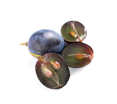 Cut and whole fresh ripe juicy grapes with seeds on white background Banque d'images