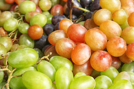 Fresh ripe juicy grapes as background, closeup