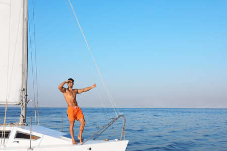 Young man relaxing on yacht during sea trip Stock Photo