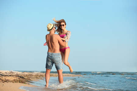 Young couple spending time together on beach
