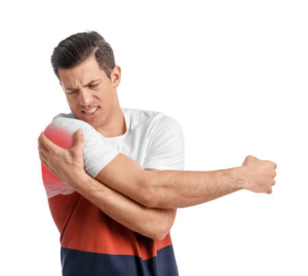 Young man suffering from shoulder pain on white background Stockfoto