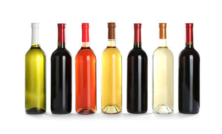 Bottles with different wine on white background Banque d'images