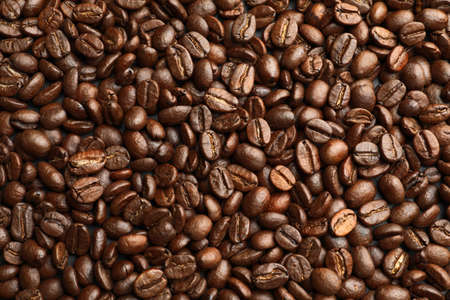 Roasted coffee beans as background, top view