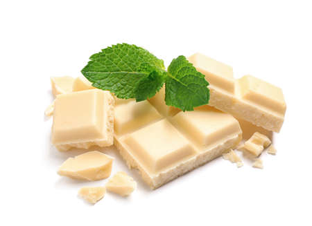 Pieces of white chocolate with mint on white background Stock Photo