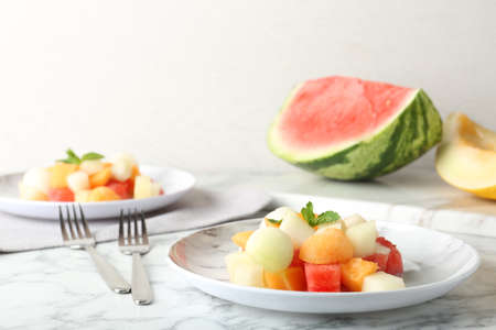 Salad with watermelon and melon on marble table
