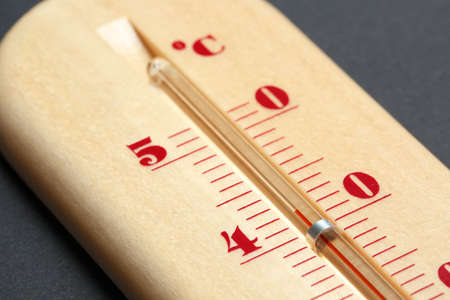 Weather thermometer on dark background, closeup view Stock Photo
