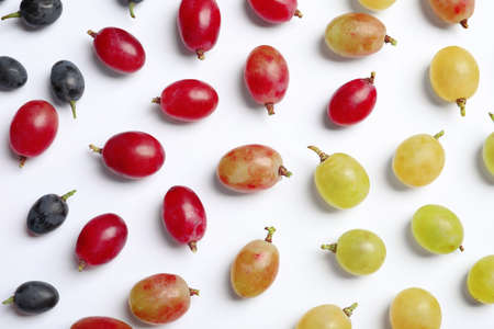 Fresh ripe juicy grapes on white background, top view Stock Photo