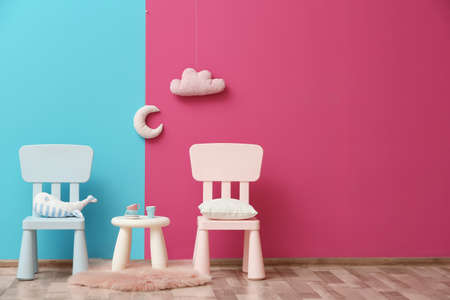 Stylish childrens room interior with toys and new furniture, space for text