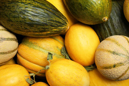 Fresh tasty ripe melons as background, top view Stock Photo