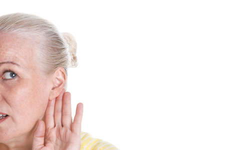 Mature woman with hearing problem on white background, closeup Stock Photo