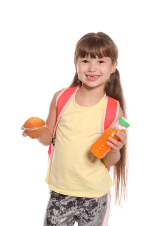 Schoolgirl with healthy food and backpack on white background Stock Photo