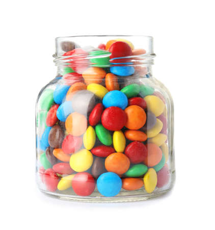 Jar with colorful candies on white background Stock Photo
