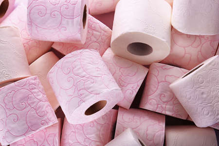 Many rolls of toilet paper as background. Personal hygiene