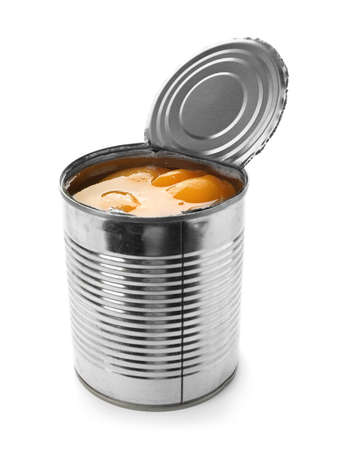 Tin can with conserved peach halves on white background Stock fotó