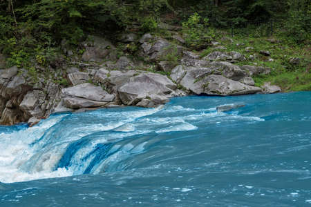 Mountain river flowing along rocky banks in wilderness