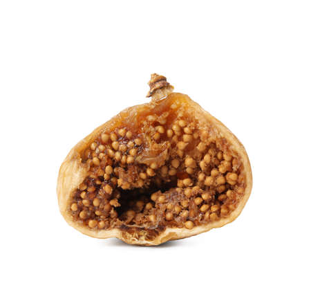 Half of delicious dried fig on white background. Organic snack