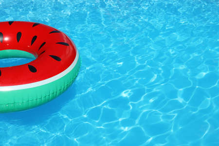 Inflatable ring floating in swimming pool on sunny day. Space for text Stock fotó - 108774329