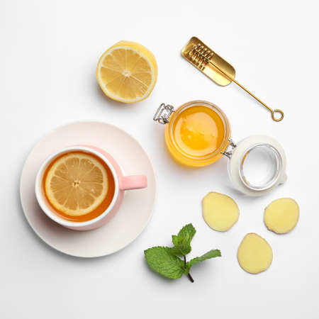 Composition with lemon tea, honey and ginger on white background, top view