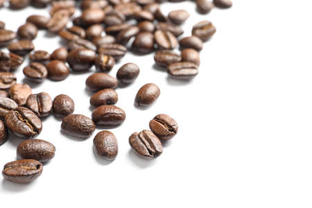 Roasted coffee beans on white background, closeup 스톡 콘텐츠