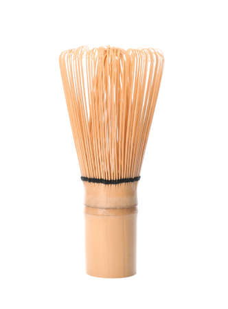 Tea whisk made of bamboo on white background