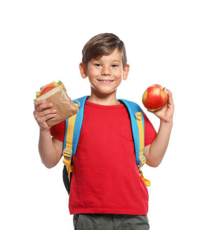 Schoolboy with healthy food and backpack on white background Фото со стока