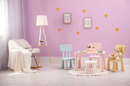 Beautiful child room interior with cute furniture and toys