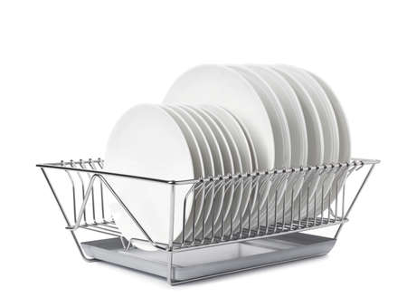 Rack with clean dishes on white background