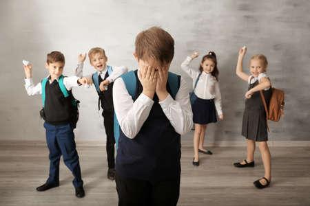 Children bullying their classmate indoors Imagens