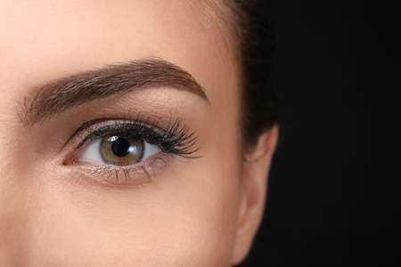 Young woman with beautiful eyebrow, closeup