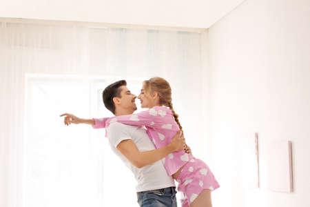 Cute young couple dancing indoors Foto de archivo