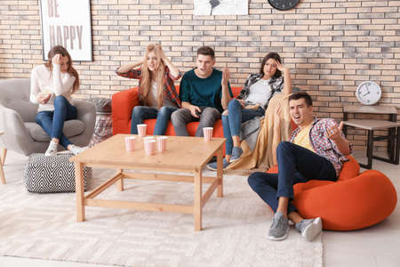 Emotional young people watching movie in home cinema Zdjęcie Seryjne