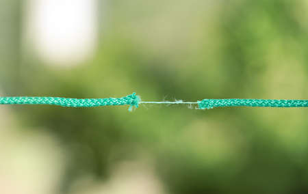 Frayed rope at breaking point against blurred background 免版税图像