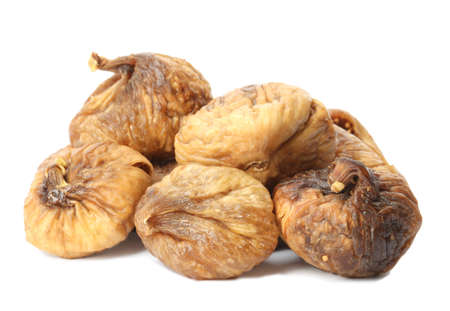 Delicious dried fig fruits on white background. Organic snack