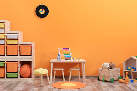 Stylish children's room interior with toys and new furniture Standard-Bild