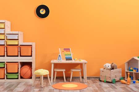 Stylish children's room interior with toys and new furniture Archivio Fotografico