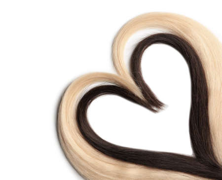 Heart made of blond and brown hair locks on white background Stockfoto