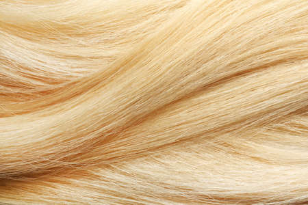Texture of healthy blond hair as background, closeup Imagens