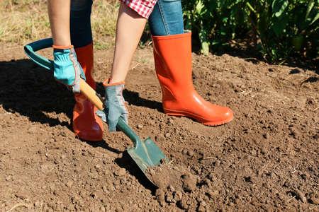 Woman digging soil with shovel outdoors. Gardening tool Reklamní fotografie