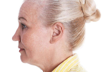 Mature woman on white background, closeup. Hearing problem