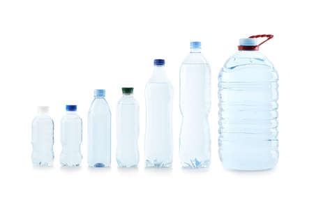 Set of different plastic bottles with pure water on white background