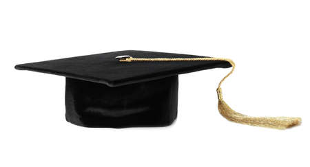 Graduation hat with gold tassel isolated on white 写真素材