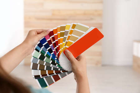 Female interior designer with color palette samples indoors, closeup Stock Photo
