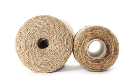 Spools of hemp rope on white background