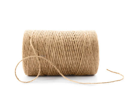 Spool of hemp rope on white background