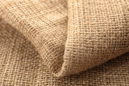 Sustainable hemp fabric as background, closeup