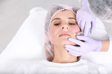 Woman undergoing face biorevitalization procedure in salon. Cosmetic treatment 스톡 콘텐츠