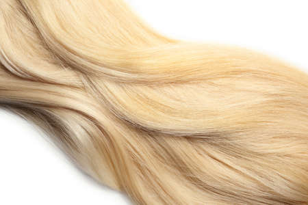 Strand of healthy blond hair on white background